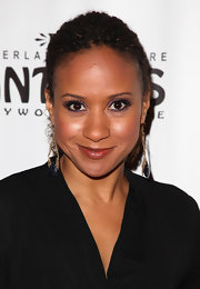 Tracie Thoms wore gold dangle earrings adorned with blue gemstones.