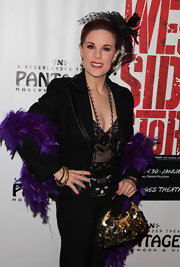 Kat Kramer added extra sparkle to her over the top look with a gold sequined purse. A purple feather boa adds to her notice-me attire.