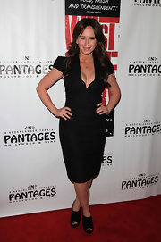 Jennifer Love Hewitt dressed down her sultry cocktail dress with chunky cutout ankle boots.