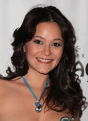 Romi Dames showed off a sparkling pendant necklace while attending the opening night of 'West Side Story'.