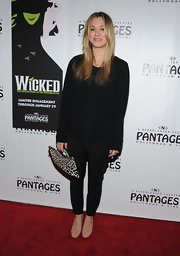 Kaley Cuoco teamed a silky black blouse with matching cigarette pants for the opening night of 'Wicked.'