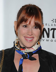 Molly Ringwald kept it simple with a ponytail and layered bangs.