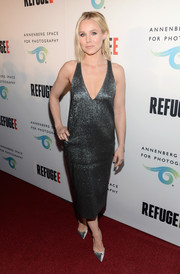 Kristen Bell went for sexy glamour in a deep-V gunmetal cocktail dress by Camilla and Marc at the REFUGEE exhibit opening.