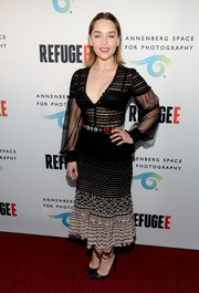 Emilia Clarke showed some skin in a low-cut sheer peplum dress by Alexander McQueen at the REFUGEE exhibit opening.