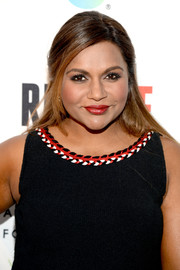 Mindy Kaling attended the REFUGEE exhibit opening sporting a sleek half-up style.
