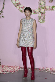 Laetitia Casta added major punch with a pair of thigh-high raspberry vinyl boots, also by Dior.