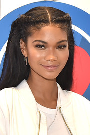 Chanel Iman framed her pretty face with this center-parted, partially braided hairstyle for the opening party of LOVE: From Cave to Keyboard.