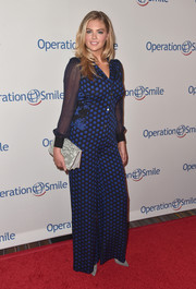 Kate Upton sheathed her famous curves in a Diane von Furstenberg polka-dot jumpsuit for the Smile Gala.