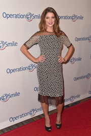 Ashley Greene donned a Lela Rose frock, featuring white embroidery on sheer black fabric, for her Smile Gala look.