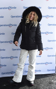 Julianne Hough completed her cold-weather look with white ski pants.