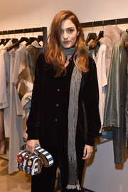 Eleonora Carisi adorned her black outfit with a striped scarf for the Optiprism by Max Mara and Safilo presentation.