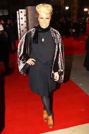 Full fluted velvet sleeves provided an opulent feel to Emeli's film awards dress.