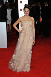 Shailene Woodley wore a strapless blush gown with rose appliques to the BAFTAs.