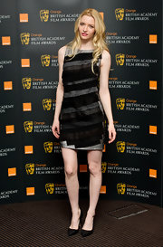 Talulah wore a gray cocktail dress with tiered layers of black fabric at the British Academy Film Awards.