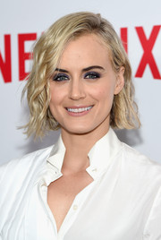 Taylor Schilling went for an edgy beauty look with smoky purple eyeshadow.