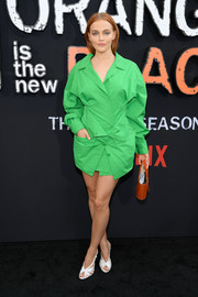 Madeline Brewer completed her outfit with white peep-toe slingback.