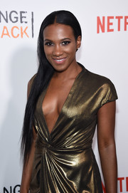 Vicky Jeudy wore her long hair straight and swept to the side when she attended the New York premiere of 'Orange is the New Black.'