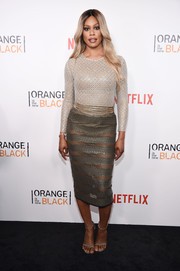 Laverne Cox sizzled in a silver bodysuit by LaQuan Smith at the New York premiere of 'Orange is the New Black.'