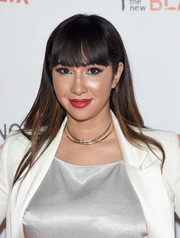 Jackie Cruz looked youthful with her long straight hair and eye-grazing bangs at the Orangecon fan event.