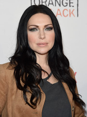 Laura Prepon stuck to her signature long raven waves when she attended the Orangecon fan event.