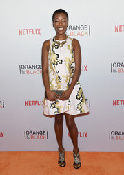 Samira Wiley attended the Orangecon fan event wearing an abstract-print A-line dress.