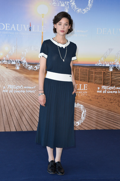 Astrid Berges Frisbey went for vintage charm in this navy and white midi dress by Chanel at the 'I Origins' photocall.