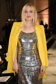 Dakota Fanning's yellow blazer and silver sequin dress at the Oscar de la Renta show were a gorgeous pairing!
