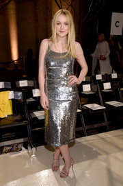 Dakota Fanning kept the shine going with a pair of metallic double-strap mules.