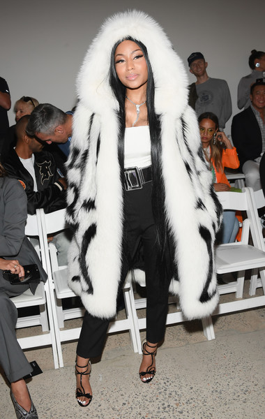 Underneath her luxe coat, Nicki Minaj sported simple high-waisted black pants and a white top.