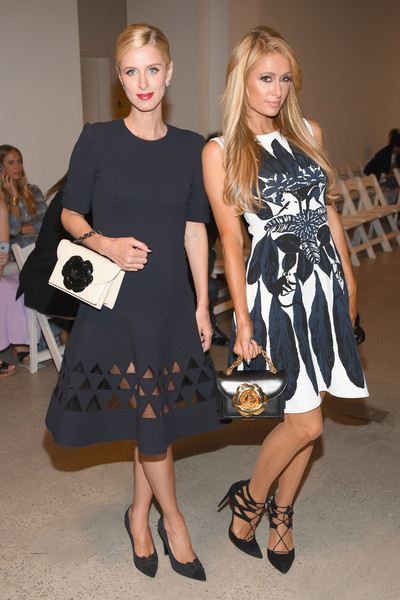 More Pics of Paris Hilton Leather Purse (5 of 6) - Evening Bags Lookbook - StyleBistro [fashion model,footwear,little black dress,fashion,dress,catwalk,beauty,flooring,lady,cocktail dress,oscar de la renta,paris hilton,nicky hilton,front row,new york city,new york fashion week,fashion show]