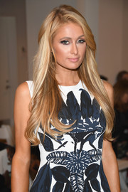 Paris Hilton showed off a gorgeous feathery hairstyle at the Oscar de la Renta fashion show.