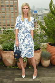 Nicky Hilton Rothschild kept it ladylike in a floral cocktail dress by Oscar de la Renta during the brand's Spring 2019 show.