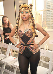 Nicki Minaj wore a novelty earflap cap-meets stuffed animal at the Oscar de la Renta Spring 2011 fashion show.