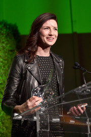Caitriona Balfe spoke onstage at the 2017 Oscar Wilde Awards wearing a black leather moto jacket over a dotted dress.