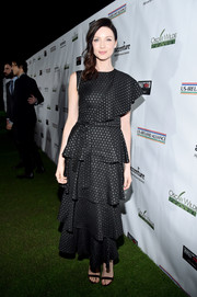 Caitriona Balfe went ultra feminine in a tiered, dotted black dress by Keti Chkhikvadze for the 2017 Oscar Wilde Awards.
