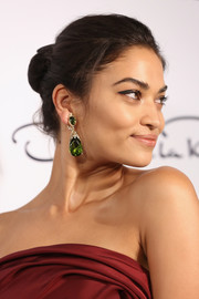 Shanina Shaik wore a huge pair of gemstone teardrop earrings for added glamour.