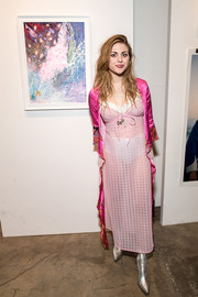 Frances Bean Cobain brought a boudoir vibe to the Other Peoples Children launch with this sheer pink slip dress and fuchsia robe combo.