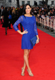 Linzi Stoppard complemented her cocktail dress with a pair of glamorous gold strappy sandals.
