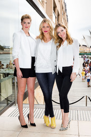 Leslie Mann kept it conservative in a long-sleeve white tie-neck blouse by Honor during the Sydney photocall for 'The Other Woman.'