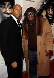 Cedric the Entertainer went for a gangsta-chic look in this fur-collared tan coat.