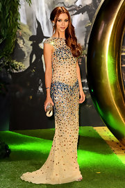 Una Healy chose a nude mermaid gown with multi-colored beaded embellishments for her elegant evening look.