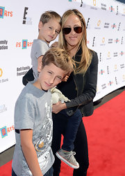 Kim Raver sported a classic pair of aviator sunglasses at the Express Yourself event, supporting P.S. ARTS.