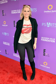 Molly Sims attended the P.S. Arts Express Yourself event wearing a black shawl-collar cardigan over a graphic tee.