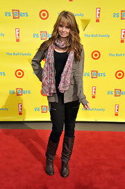 Debby Ryan struck a pose at the Express Yourself 2010 event in slouchy brown leather knee high boots.