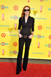 Marcia wears a cowel neck blouse to 'Express Yourself 2010'.  She pairs this casual top with black jeans and a belt.