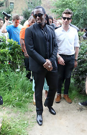Sean Combs attended an event at Toffee Park Adventure Playground and Youth Center wearing an elegant pair of crocodile slip-on shoes.