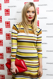 To match her bold red lips, Laura Whitmore carried a playful Lulu Guinness lip-shaped clutch at the Pandora & BHF afternoon tea in London, England.
