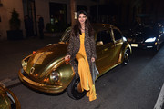Victoria Justice arrived for the Pandora Jewelry Shine Collection launch wearing a leopard-print coat over a canary-yellow top and pants combo.