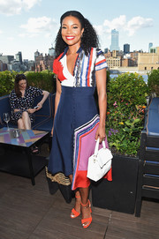 Gabrielle Union tied her look together with a white leather purse.