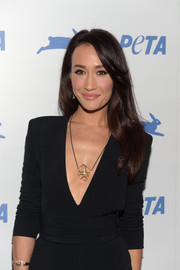 Maggie Q adorned her bare neckline with an abstract gold pendant necklace for PETA's 35th anniversary party.